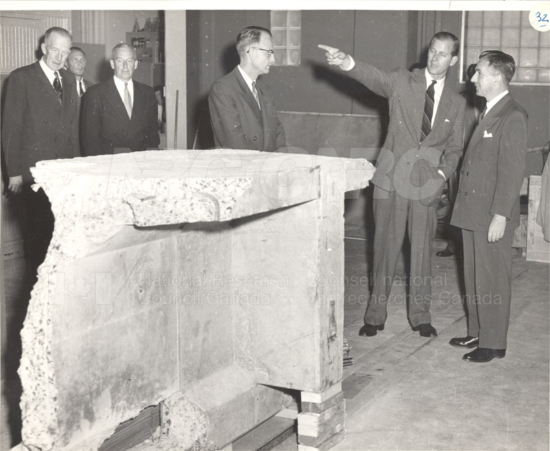 Dr. R.F. Legget and Company with a Huge Chunk of Concrete