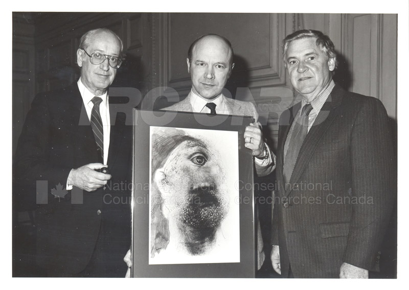 NATO Presentation of Lithograph to NRC (C.T. Bishop, A. Szabo, P.E. Beaulieu) 1984