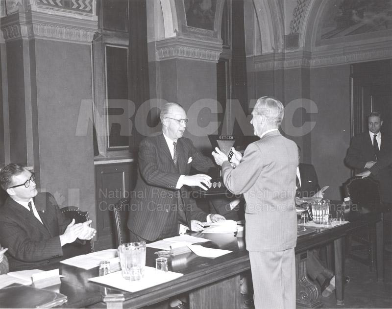 Presentation of Awards for Fire Prevention Contest Winner NRC, Dr. Steacie, J. Elliott 1961, 1962 006