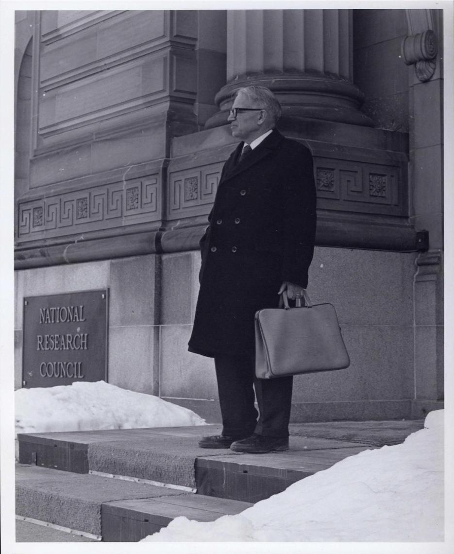 Tab 1: Gerhard Herzberg on steps of NRC, 100 Sussex Drive, February 1985, photo 1