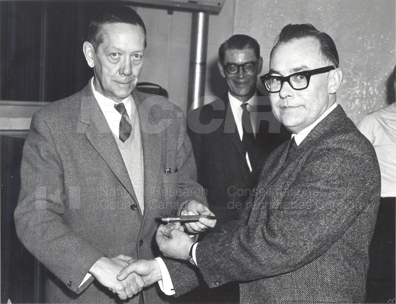 Presentation of Firing Key Memento by J.H. Brady to W.L. Haney to Commemorate the Launching of First Canadian Rocket under NRC Sponsorship March 1966