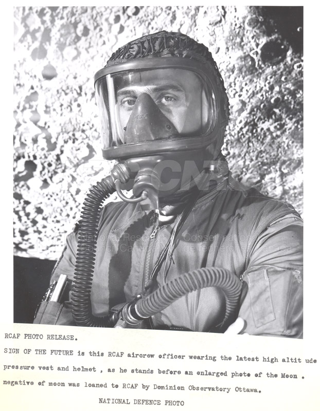 R.C.A.F. Aircrew Officer Wearing the Latest High Altitude Pressure Vest and Helmet