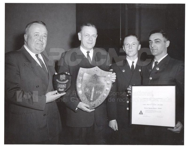 Presentation of Awards for Fire Prevention Contest Winner NRC, Dr. Steacie, J. Elliott 1961, 1962 005