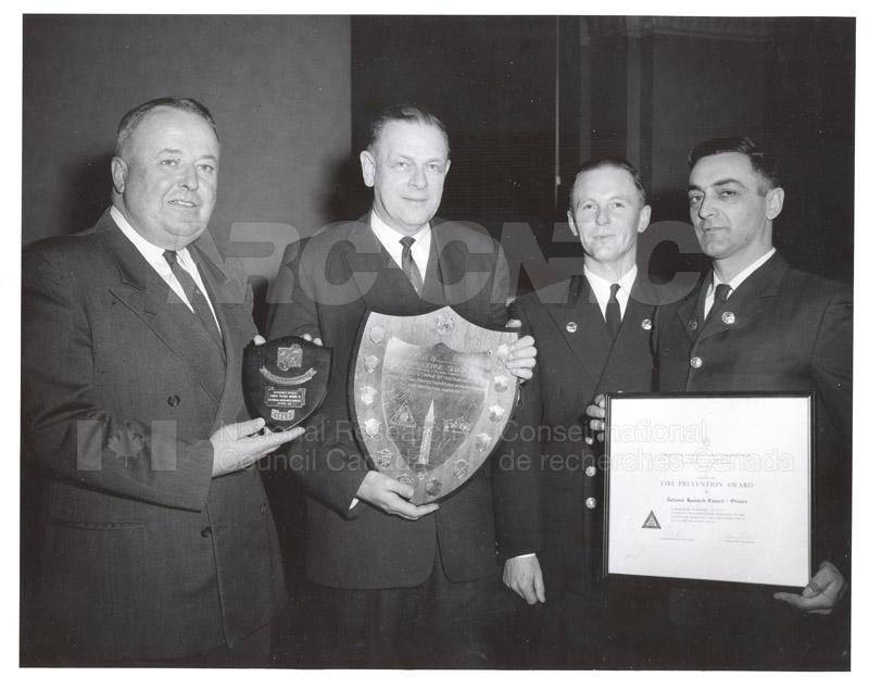 Presentation of Awards for Fire Prevention Contest Winner NRC, Dr. Steacie, J. Elliott 1961, 1962 005