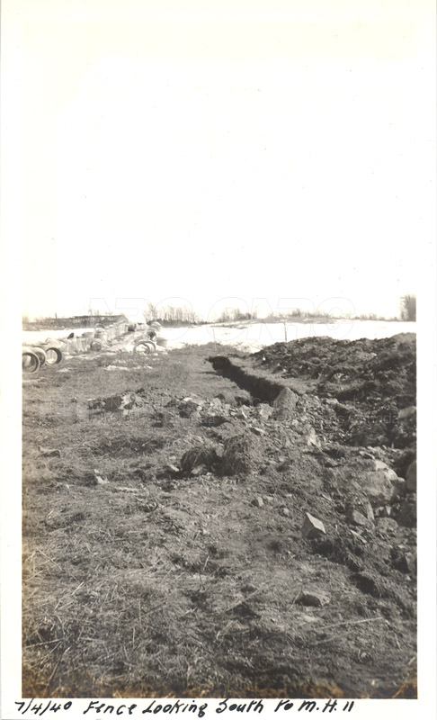 Album 12 New Annex 2 Fence looking South to M.H.11 April 7 1940