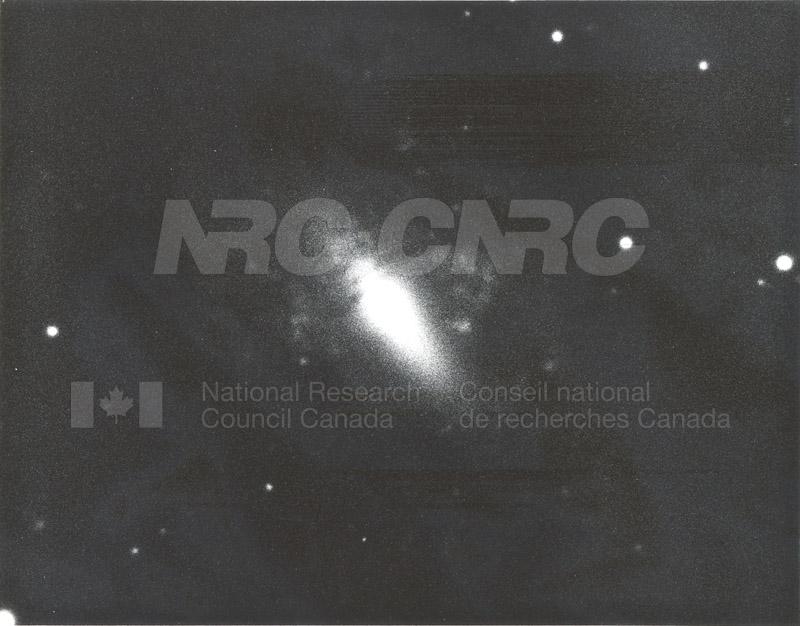 Galaxies- Barred Spiral Nebula in Ursa Major- Mount Wilson and Palomar Observatories