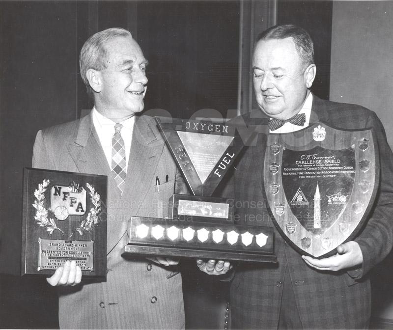 Presentation of Awards for Fire Prevention Contest Winner NRC, Dr. Steacie, J. Elliott 1961, 1962 003